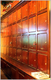 Wall of cabinets at Telford's Pipe & Cigar